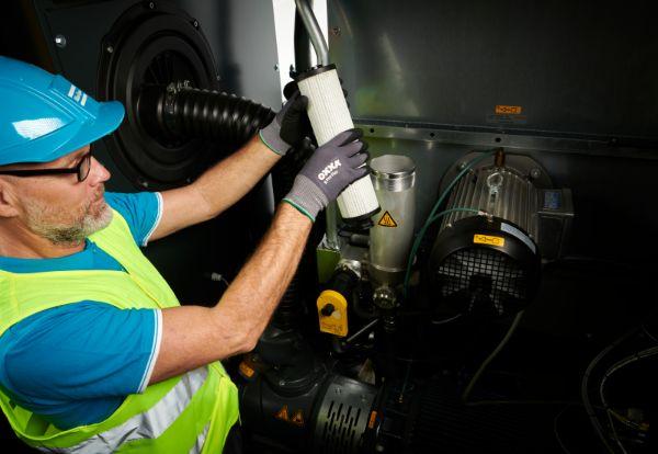 Technician Servicing Competitor Machine - For web